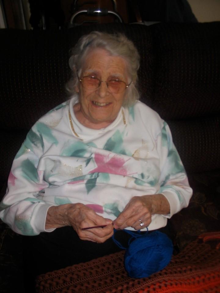 Resident demonstrating how to crochet
